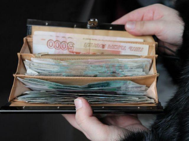 Як вибрати гаманець за знаком зодіаку? Який колір гаманця притягує гроші за знаком зодіаку?
